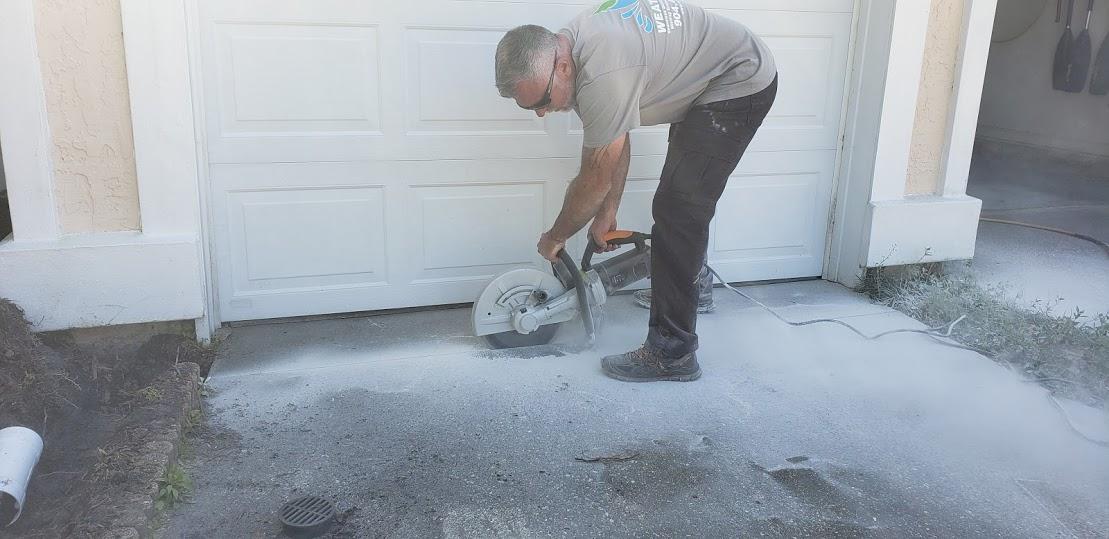 Driveway grate drain - WeatherTek, LLC | Jacksonville, FL